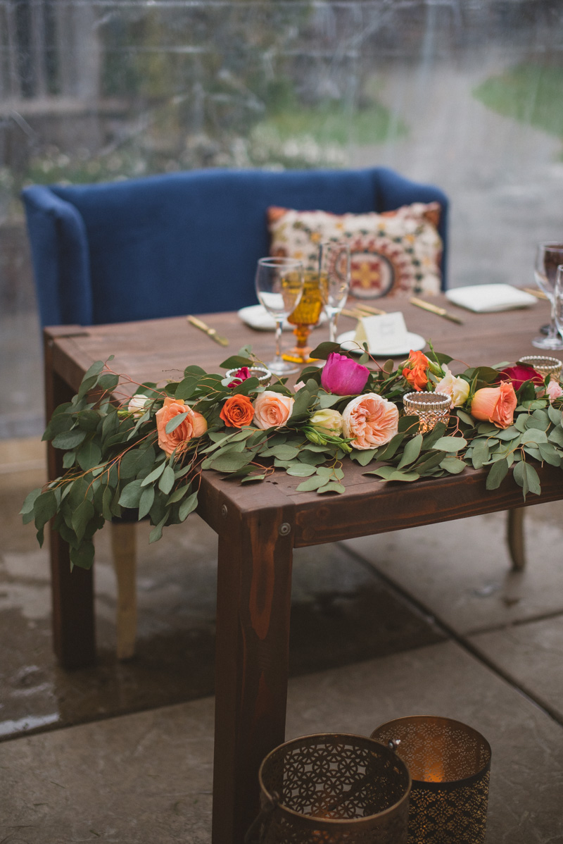 bohemian sweetheart tables - https://ruffledblog.com/eclectic-rainy-day-wedding-with-moroccan-accents