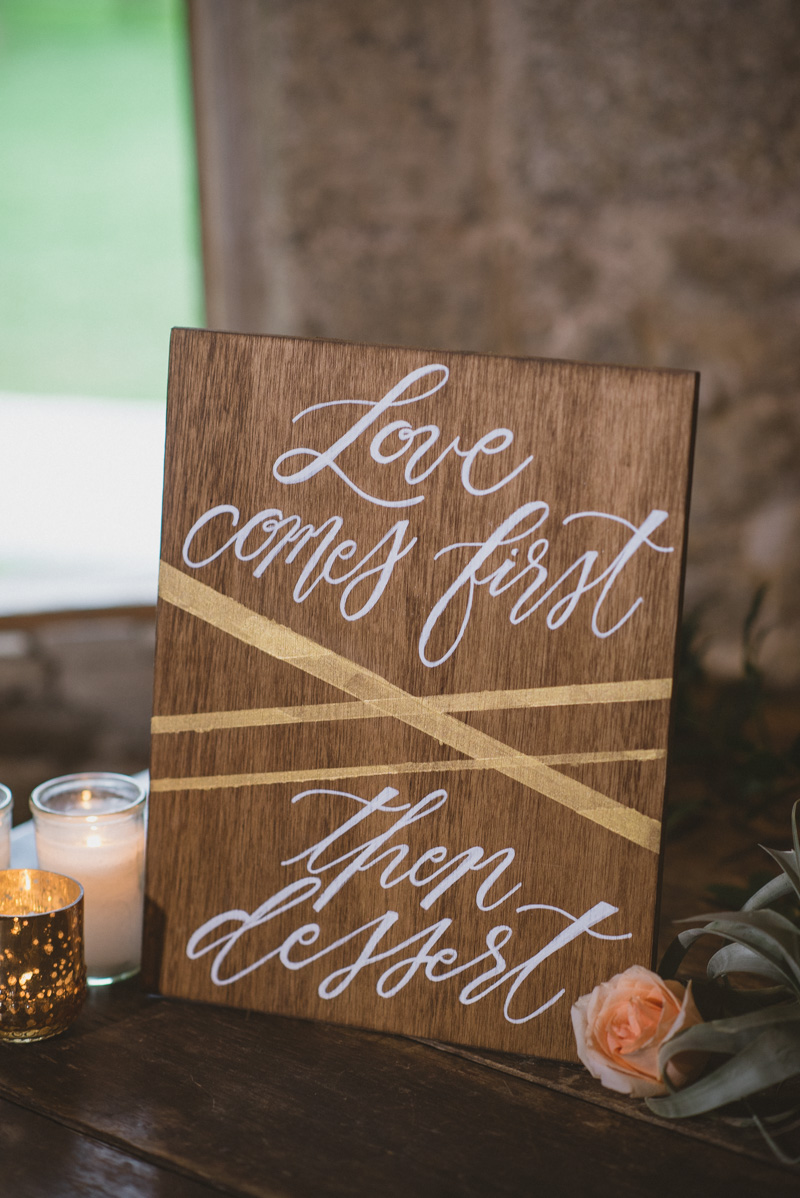wooden wedding signs with gold accents - https://ruffledblog.com/eclectic-rainy-day-wedding-with-moroccan-accents