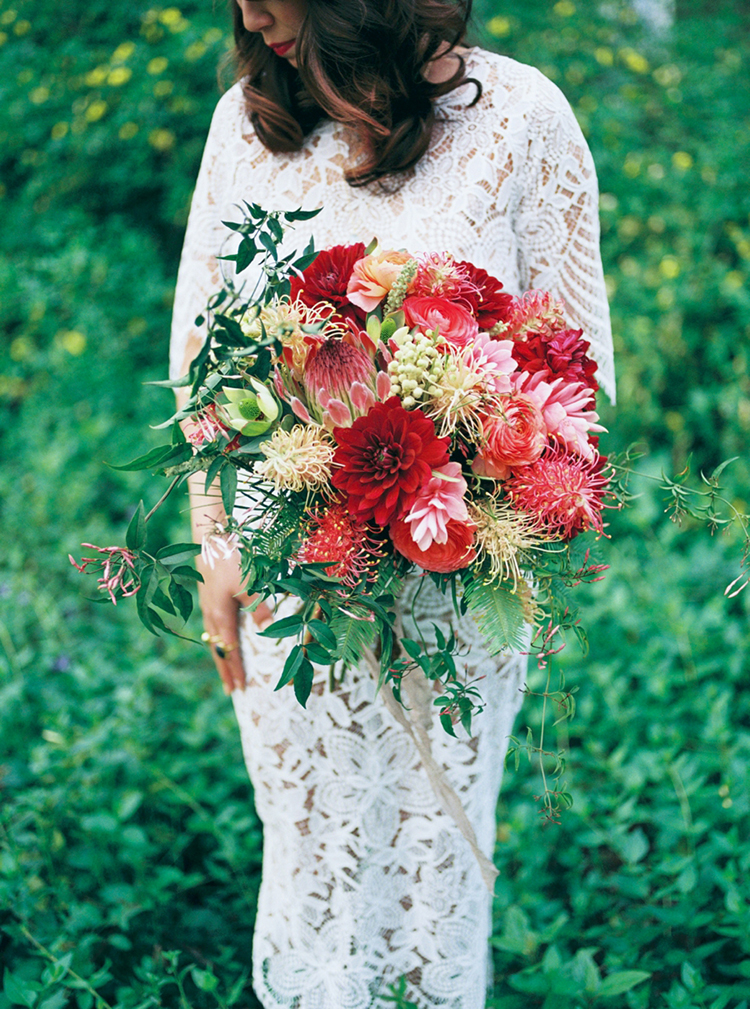 lush red bouquets with protea - photo by Elisabeth Arin Photography http://ruffledblog.com/eclectic-wedding-ideas-inspired-by-wanderlust