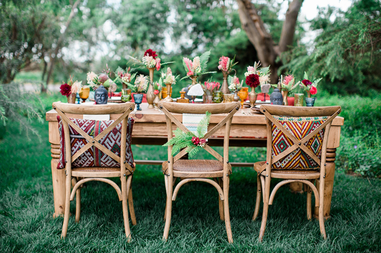 bohemian wedding tables - photo by Elisabeth Arin Photography http://ruffledblog.com/eclectic-wedding-ideas-inspired-by-wanderlust