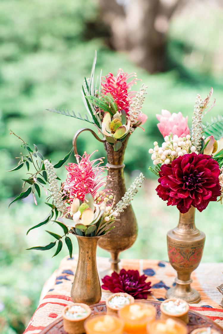 dahlias in bud vases - photo by Elisabeth Arin Photography http://ruffledblog.com/eclectic-wedding-ideas-inspired-by-wanderlust