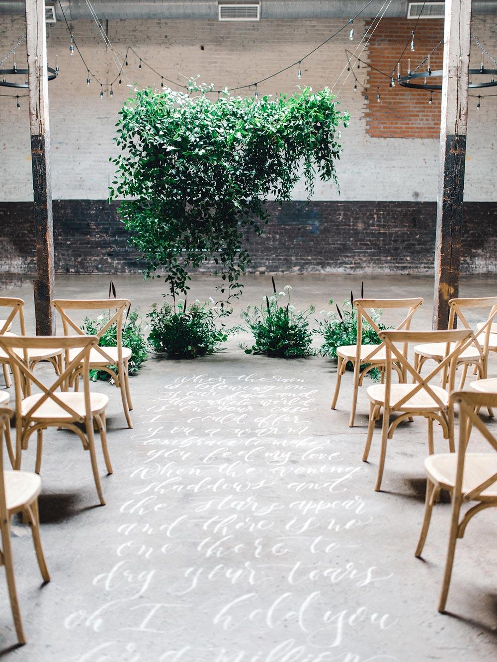 suspended greenery wedding ceremony backdrop
