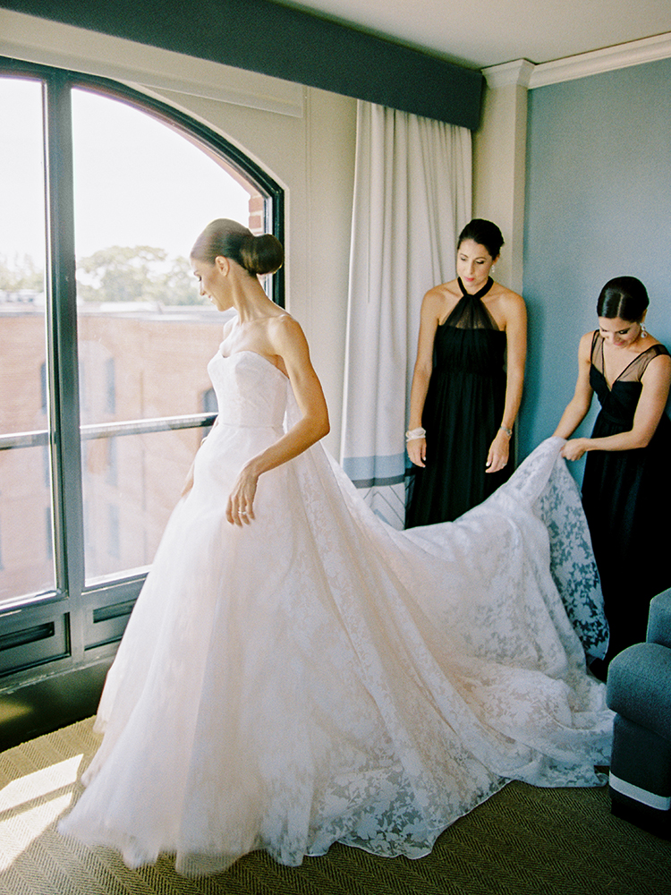 bride getting ready with bridesmaids - photo by Love by Serena https://ruffledblog.com/elegant-annapolis-wedding-with-romantic-greenery