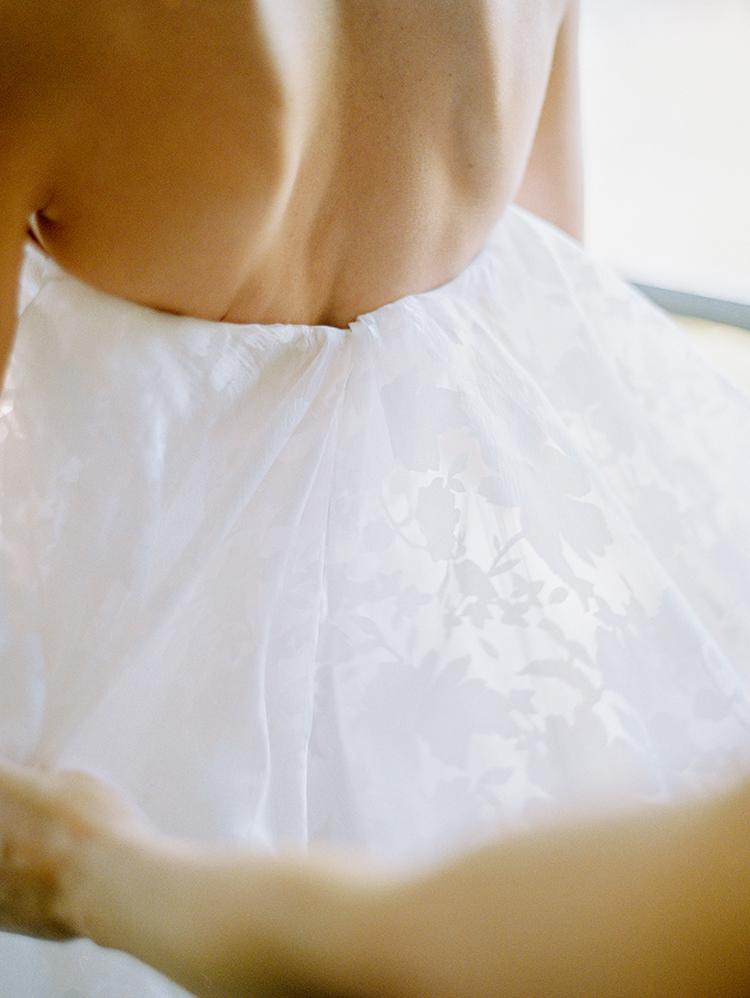romantic modern wedding dresses - photo by Love by Serena https://ruffledblog.com/elegant-annapolis-wedding-with-romantic-greenery