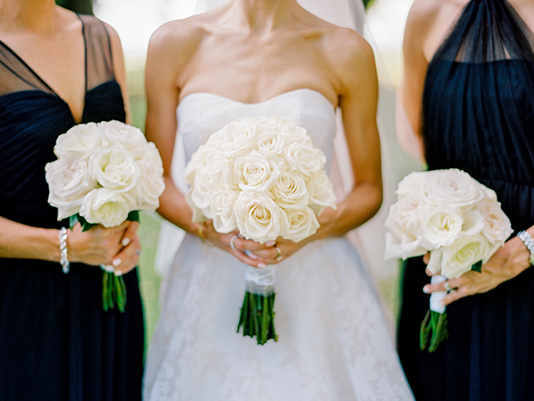 simple ivory rose bouquets - photo by Love by Serena http://ruffledblog.com/elegant-annapolis-wedding-with-romantic-greenery