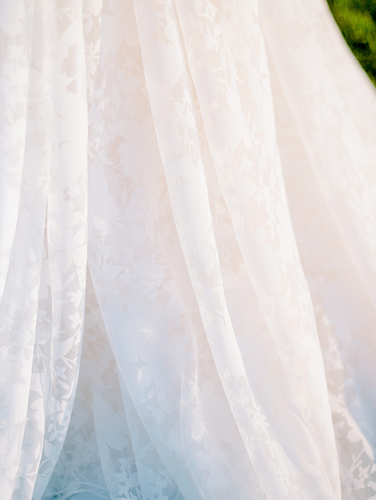 romantic lace wedding gowns - photo by Love by Serena http://ruffledblog.com/elegant-annapolis-wedding-with-romantic-greenery