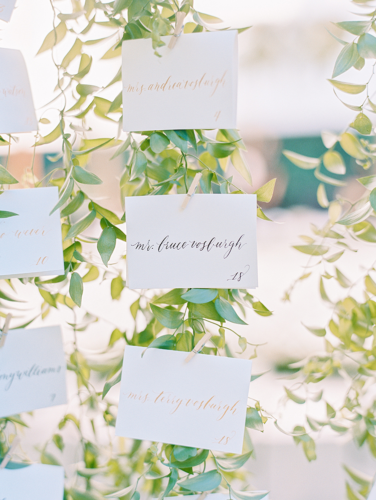 seating charts with romantic greenery - photo by Love by Serena http://ruffledblog.com/elegant-annapolis-wedding-with-romantic-greenery