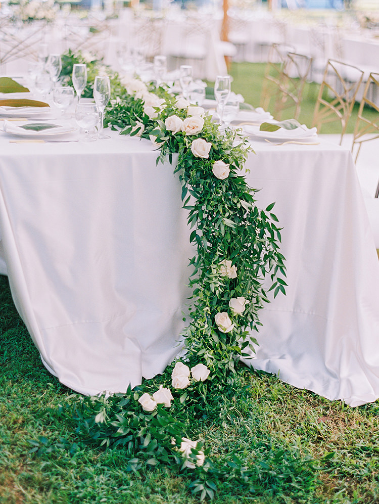 wedding tables with greenery runners - photo by Love by Serena http://ruffledblog.com/elegant-annapolis-wedding-with-romantic-greenery