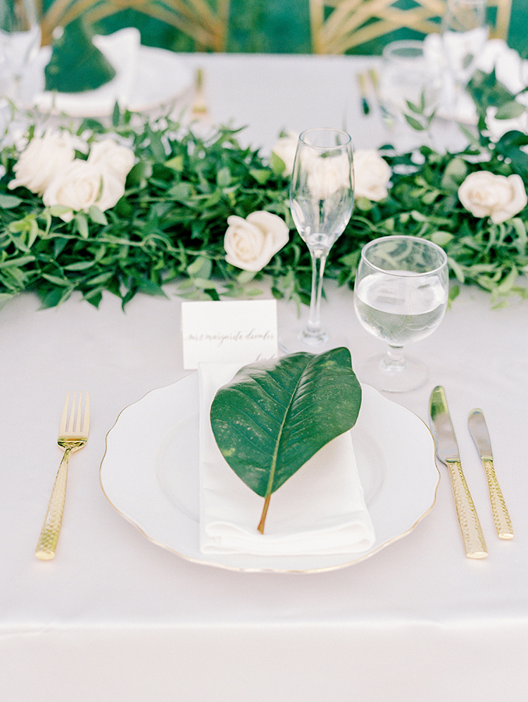 leaf place settings - photo by Love by Serena http://ruffledblog.com/elegant-annapolis-wedding-with-romantic-greenery