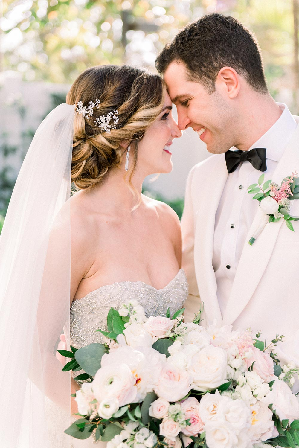 strapless embellished wedding dress and white groom tux