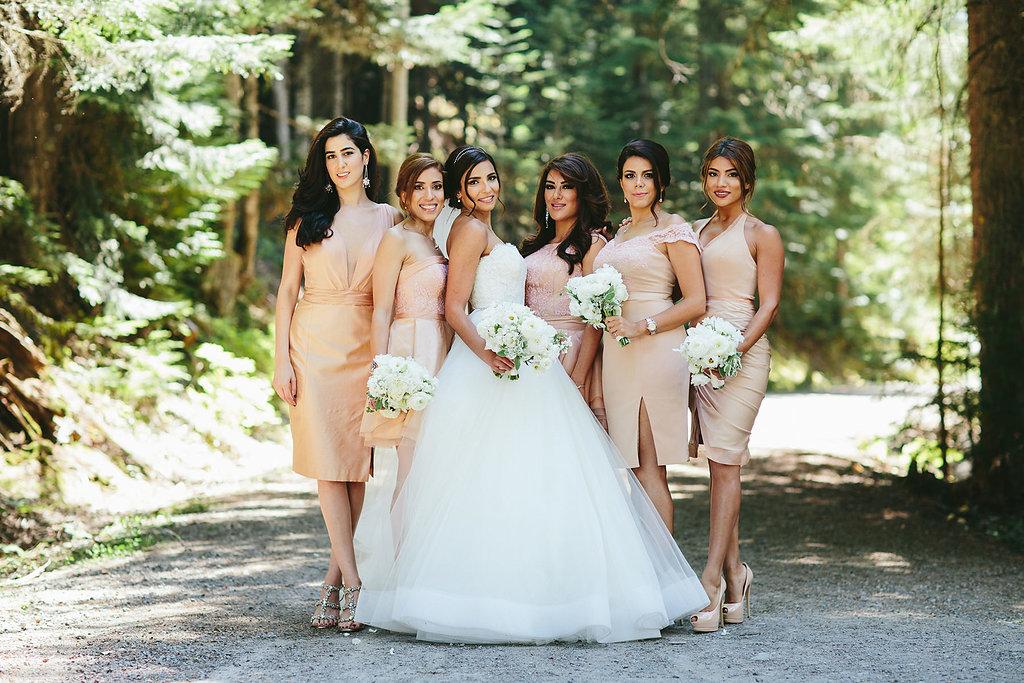 neutral bridesmaid dresses - photo by Melia Lucida http://ruffledblog.com/elegant-canadian-wedding-with-greenery