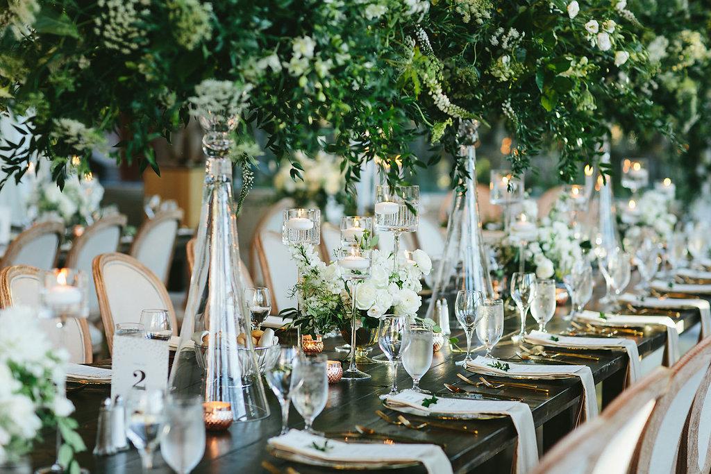 wedding tablescapes - photo by Melia Lucida http://ruffledblog.com/elegant-canadian-wedding-with-greenery