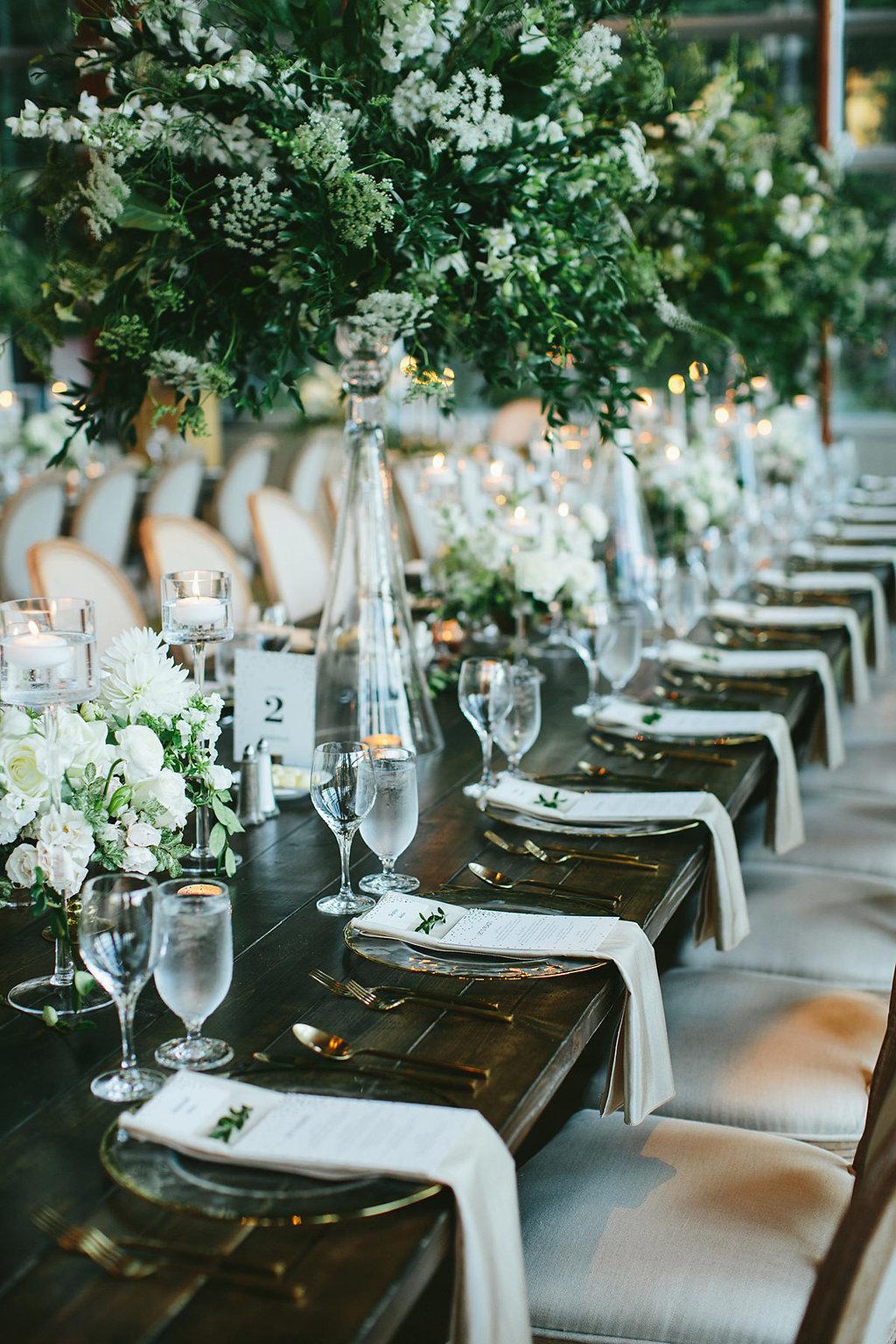 wedding tablescapes - photo by Melia Lucida https://ruffledblog.com/elegant-canadian-wedding-with-greenery