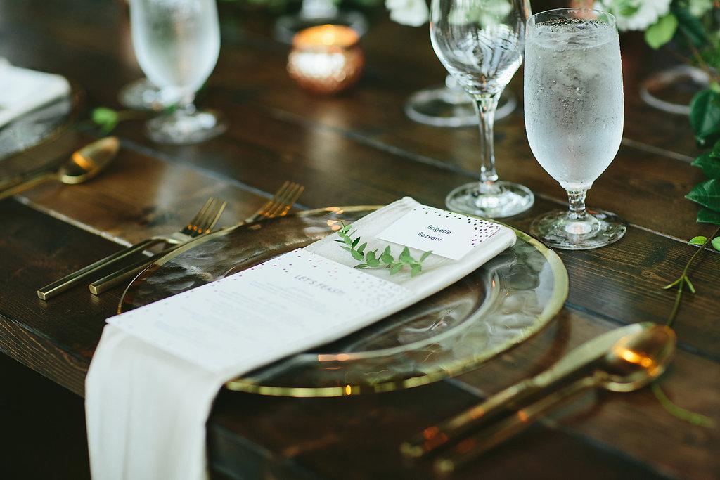 place settings - photo by Melia Lucida https://ruffledblog.com/elegant-canadian-wedding-with-greenery