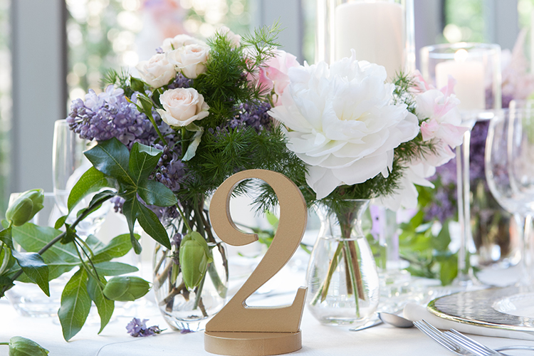 gold table numbers - photo by 5ive 5ifteen http://ruffledblog.com/elegant-garden-inspired-toronto-wedding