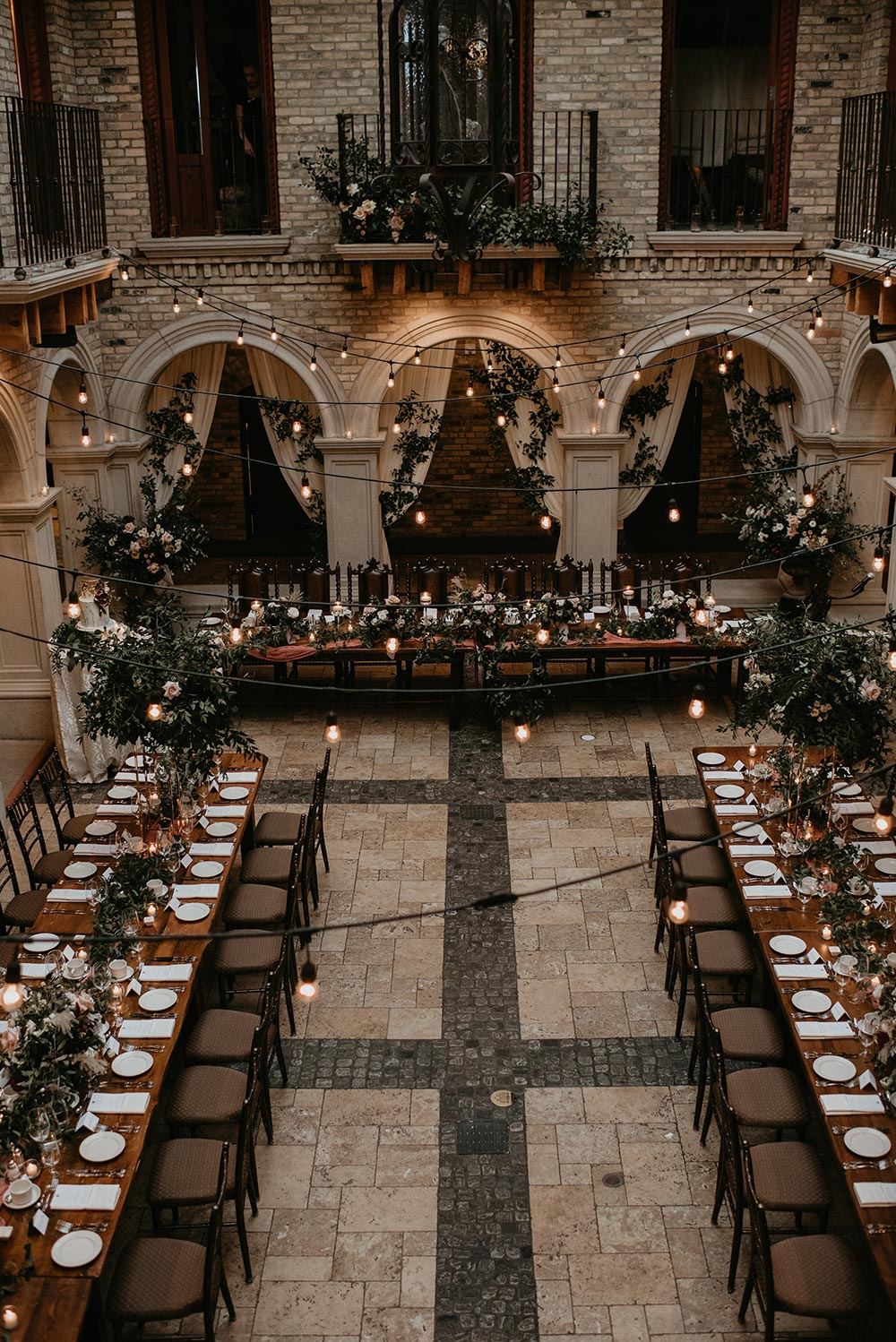 We thought this real wedding was an editorial because it's that perfect #indoorweddingvenue #longreceptiontables #chicwedding