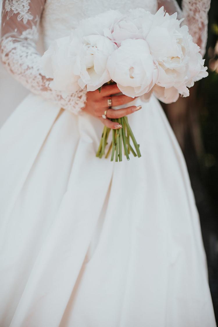 ivory peony bouquets - photo by Alexandra Wallace https://ruffledblog.com/elegant-san-luis-obispo-garden-party-wedding