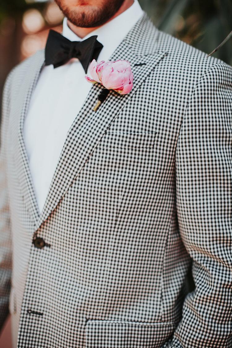 checkered grooms suits - photo by Alexandra Wallace https://ruffledblog.com/elegant-san-luis-obispo-garden-party-wedding