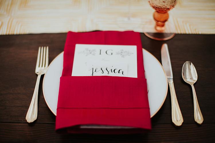 red place settings - photo by Alexandra Wallace https://ruffledblog.com/elegant-san-luis-obispo-garden-party-wedding