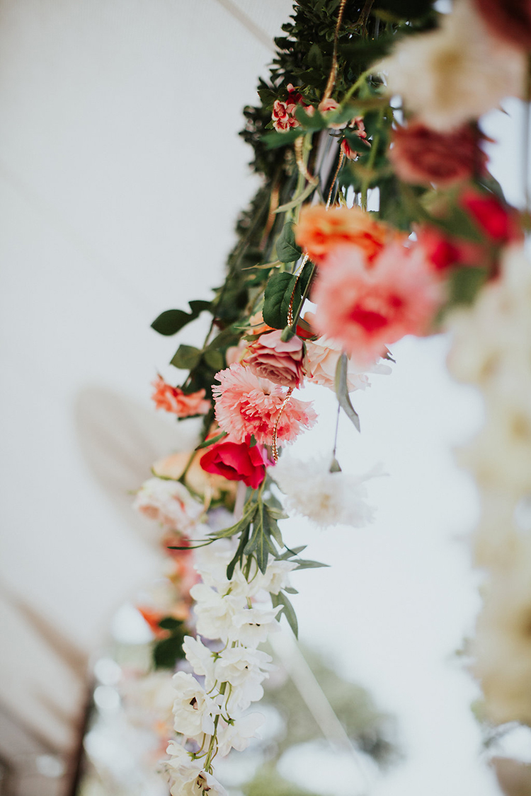hanging floral decor - photo by Alexandra Wallace https://ruffledblog.com/elegant-san-luis-obispo-garden-party-wedding