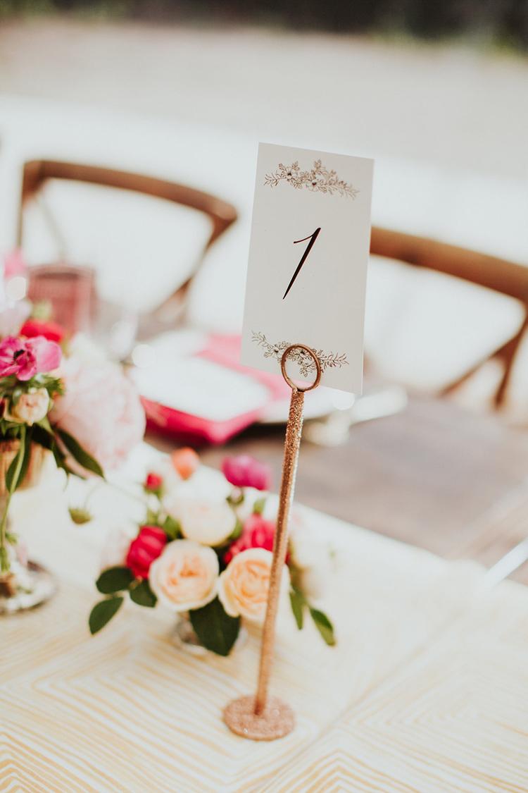 paper table numbers - photo by Alexandra Wallace https://ruffledblog.com/elegant-san-luis-obispo-garden-party-wedding
