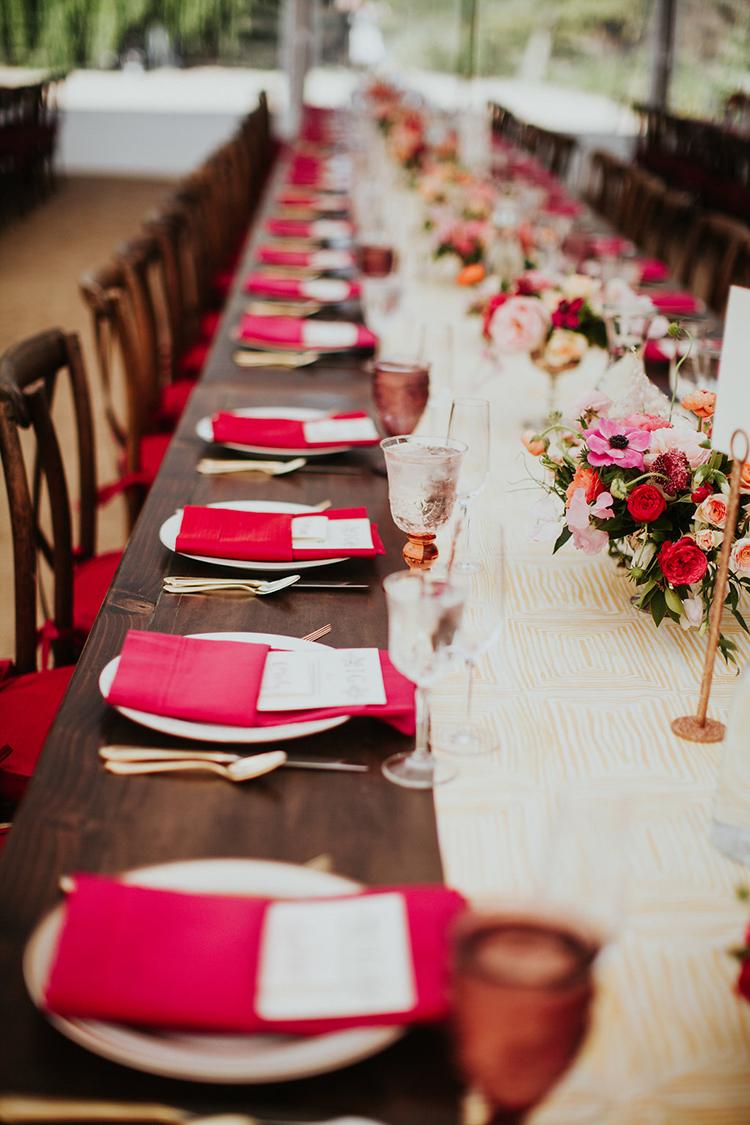 red tablescapes - photo by Alexandra Wallace https://ruffledblog.com/elegant-san-luis-obispo-garden-party-wedding