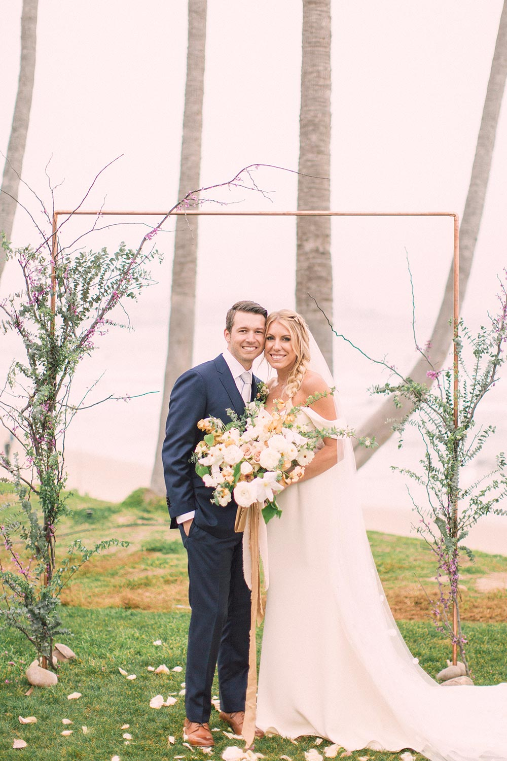 off the shoulder wedding dress and minimalist wedding ceremony arch with climbing greenery