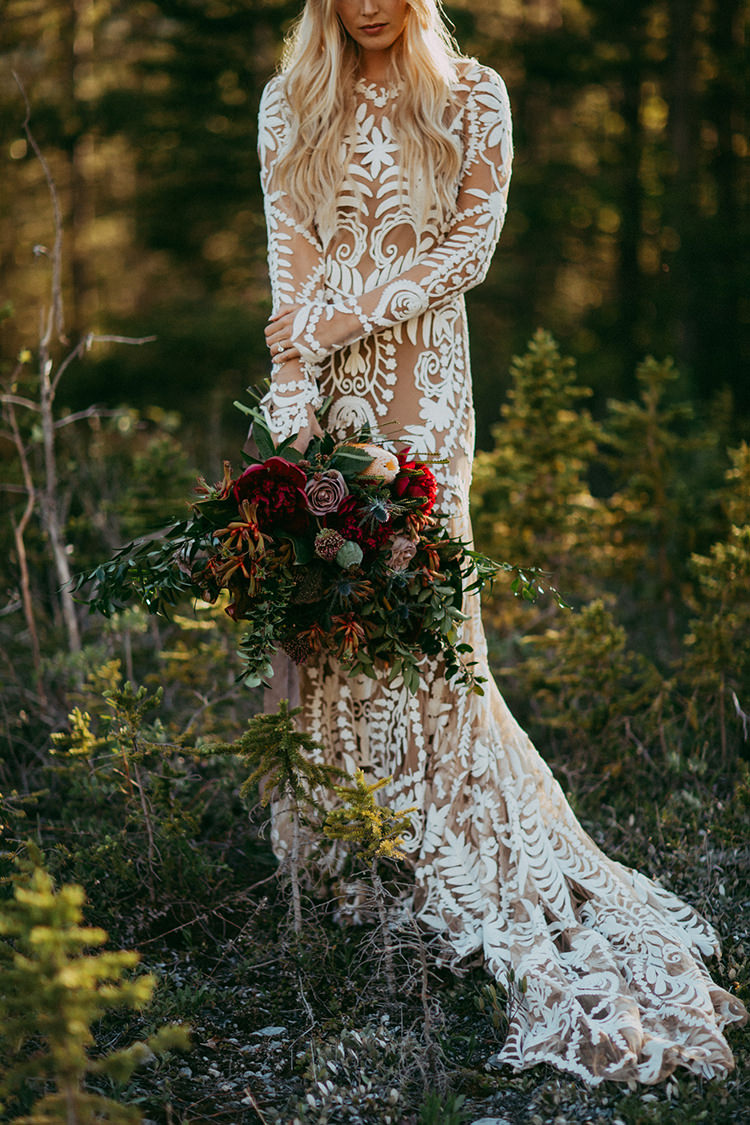 bohemian lace wedding gowns - photo by Tricia Victoria Photography http://ruffledblog.com/elopement-inspiration-with-a-show-stopping-boho-lace-gown
