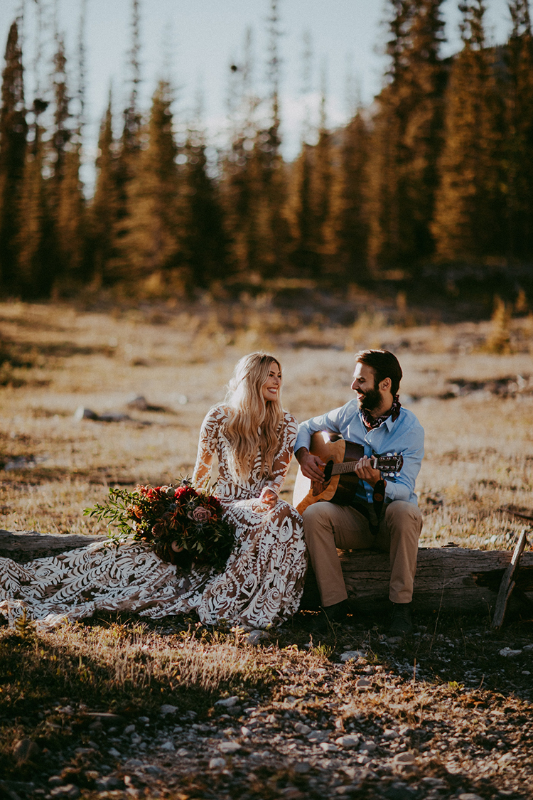 groom playing guitar - photo by Tricia Victoria Photography http://ruffledblog.com/elopement-inspiration-with-a-show-stopping-boho-lace-gown