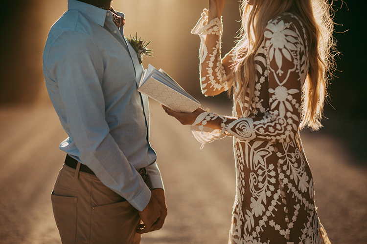 vow exchanges - photo by Tricia Victoria Photography http://ruffledblog.com/elopement-inspiration-with-a-show-stopping-boho-lace-gown