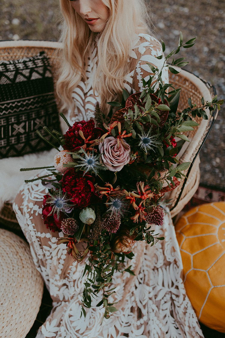 wild bohemian wedding bouquets - photo by Tricia Victoria Photography http://ruffledblog.com/elopement-inspiration-with-a-show-stopping-boho-lace-gown