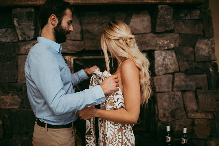 bride getting ready - photo by Tricia Victoria Photography http://ruffledblog.com/elopement-inspiration-with-a-show-stopping-boho-lace-gown