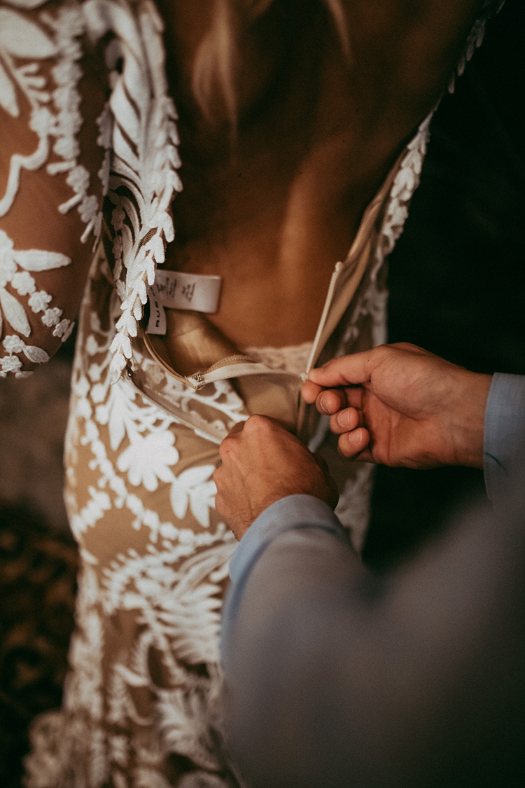 bride getting ready for an elopement - photo by Tricia Victoria Photography http://ruffledblog.com/elopement-inspiration-with-a-show-stopping-boho-lace-gown