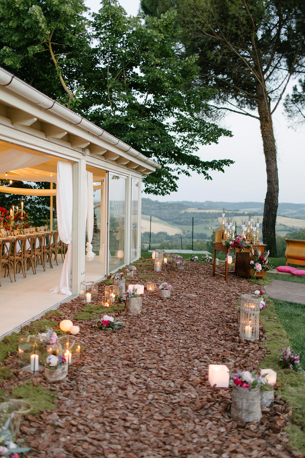 tuscan countryside wedding cocktail hour soft candlelight