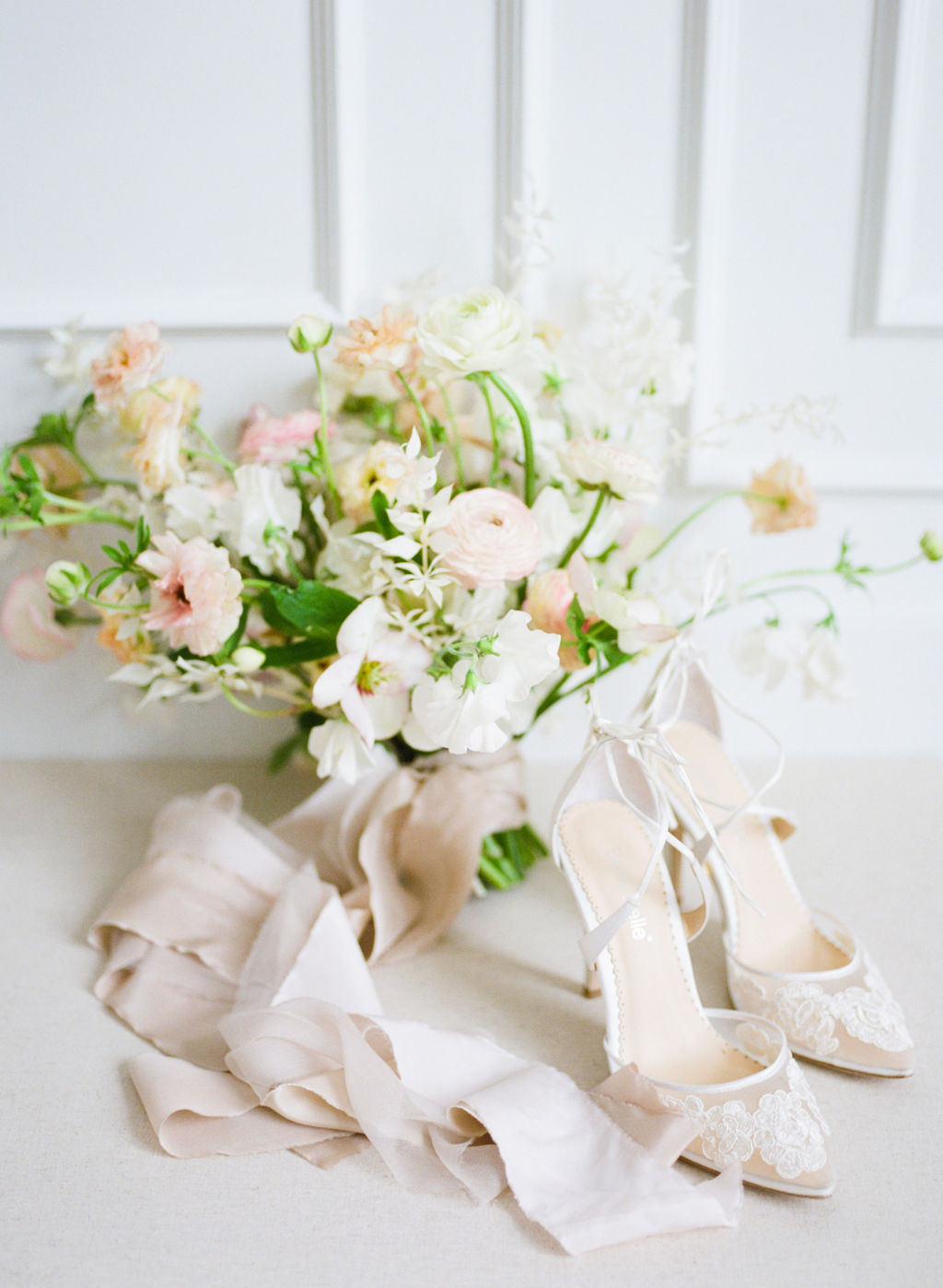 wedding bouquet and lace wedding shoes