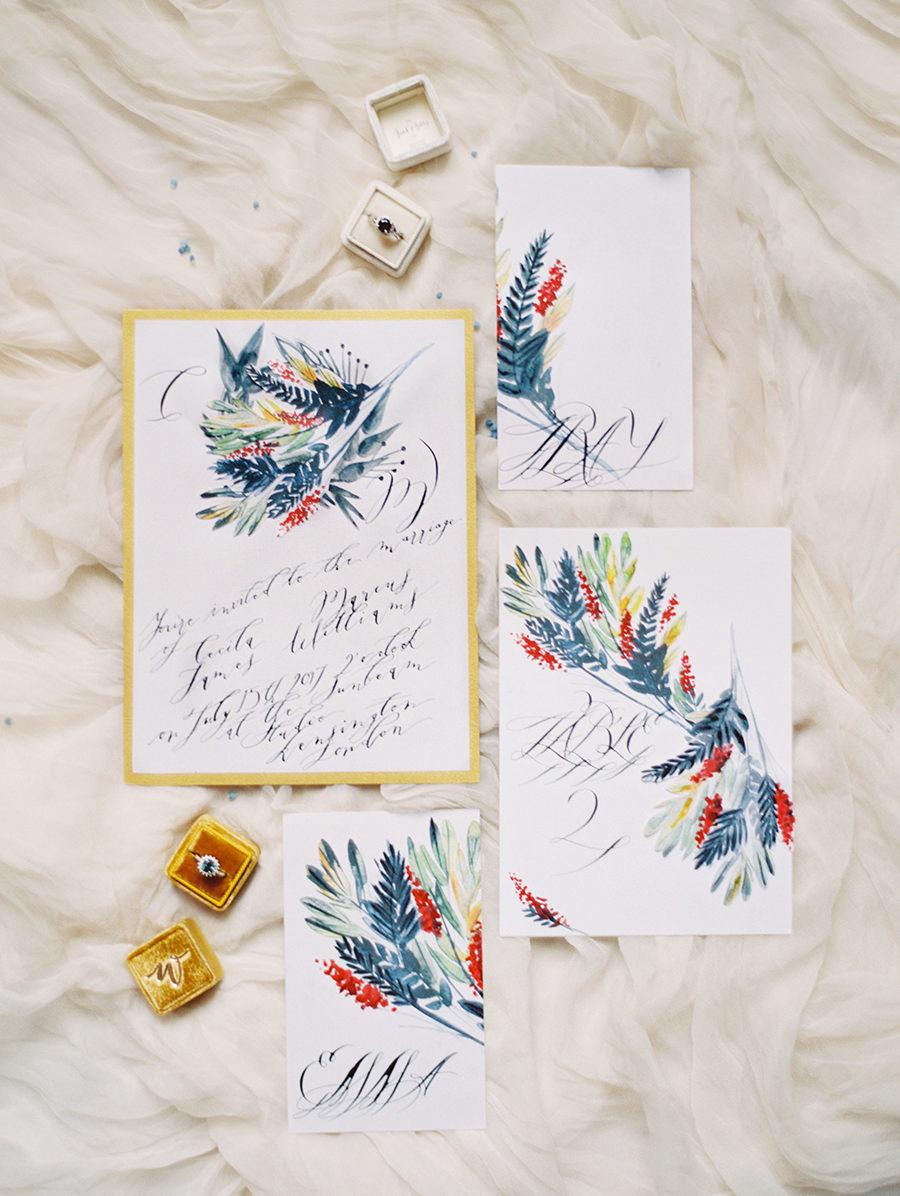 dramatic hand painted wedding invitations - photo by Igor Kovchegin Photography http://ruffledblog.com/ethereal-wedding-inspiration-with-teal-and-marigold