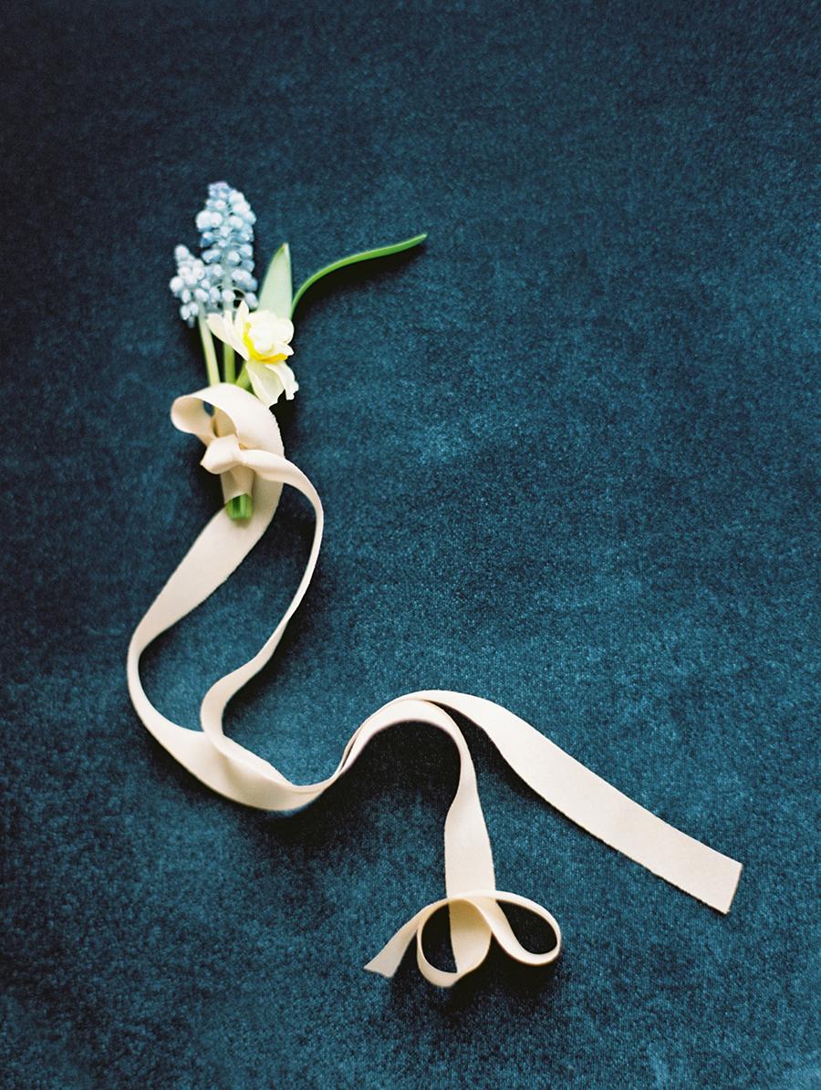 blue boutonnieres - photo by Igor Kovchegin Photography http://ruffledblog.com/ethereal-wedding-inspiration-with-teal-and-marigold