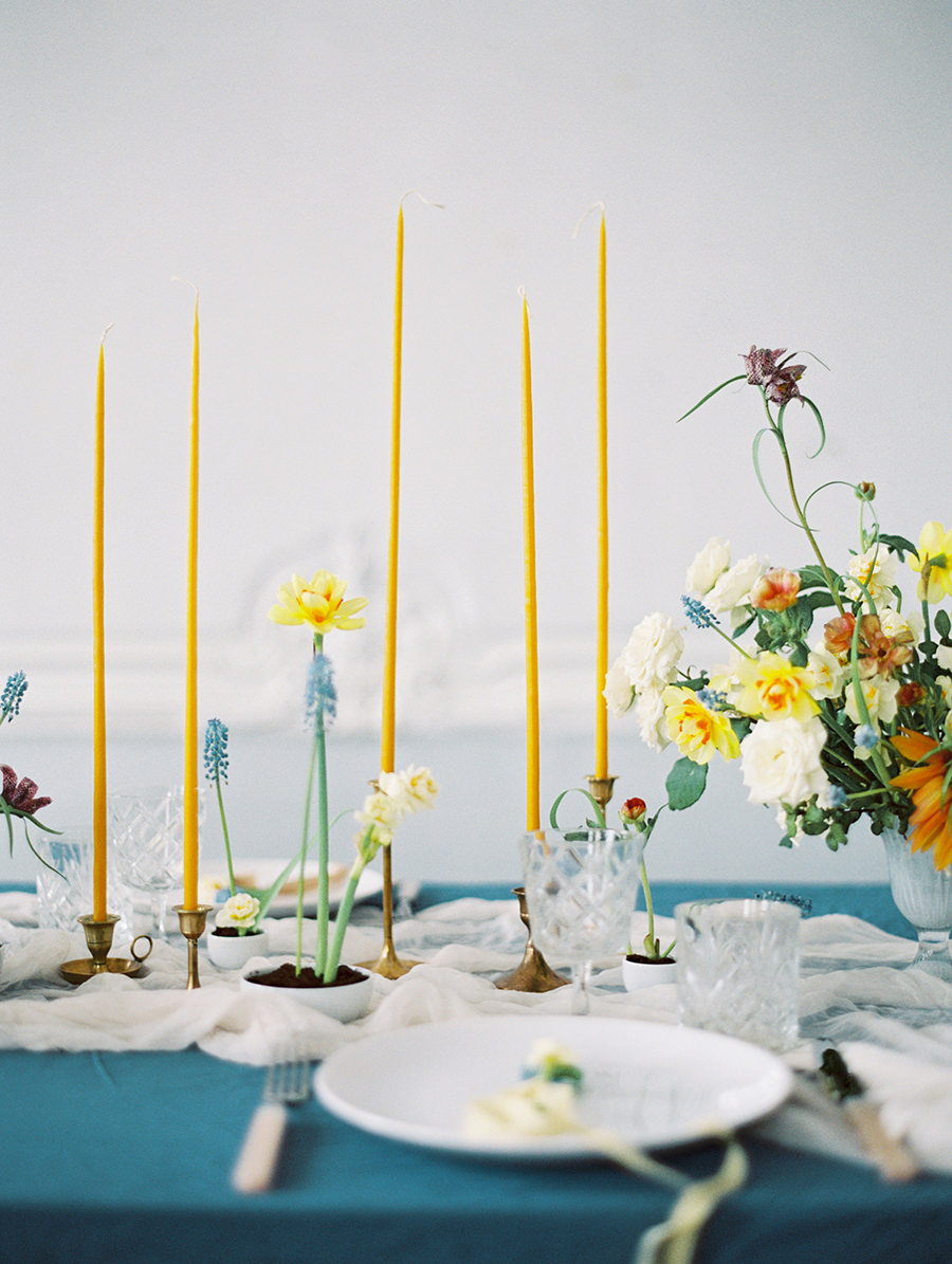 skinny yellow candlesticks - photo by Igor Kovchegin Photography https://ruffledblog.com/ethereal-wedding-inspiration-with-teal-and-marigold