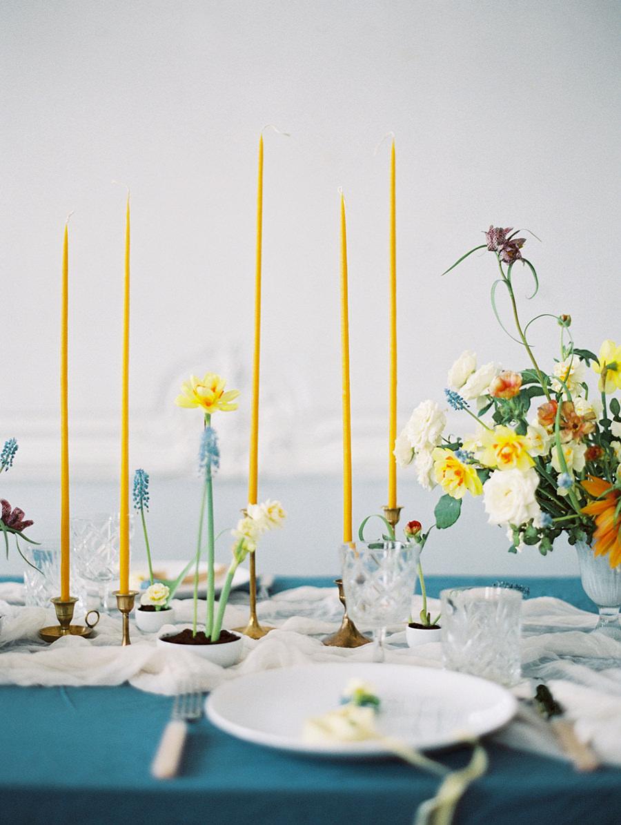 skinny yellow candlesticks - photo by Igor Kovchegin Photography http://ruffledblog.com/ethereal-wedding-inspiration-with-teal-and-marigold