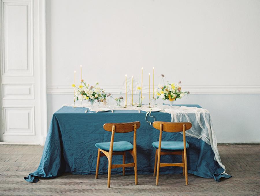 blue wedding tablecloths - photo by Igor Kovchegin Photography http://ruffledblog.com/ethereal-wedding-inspiration-with-teal-and-marigold