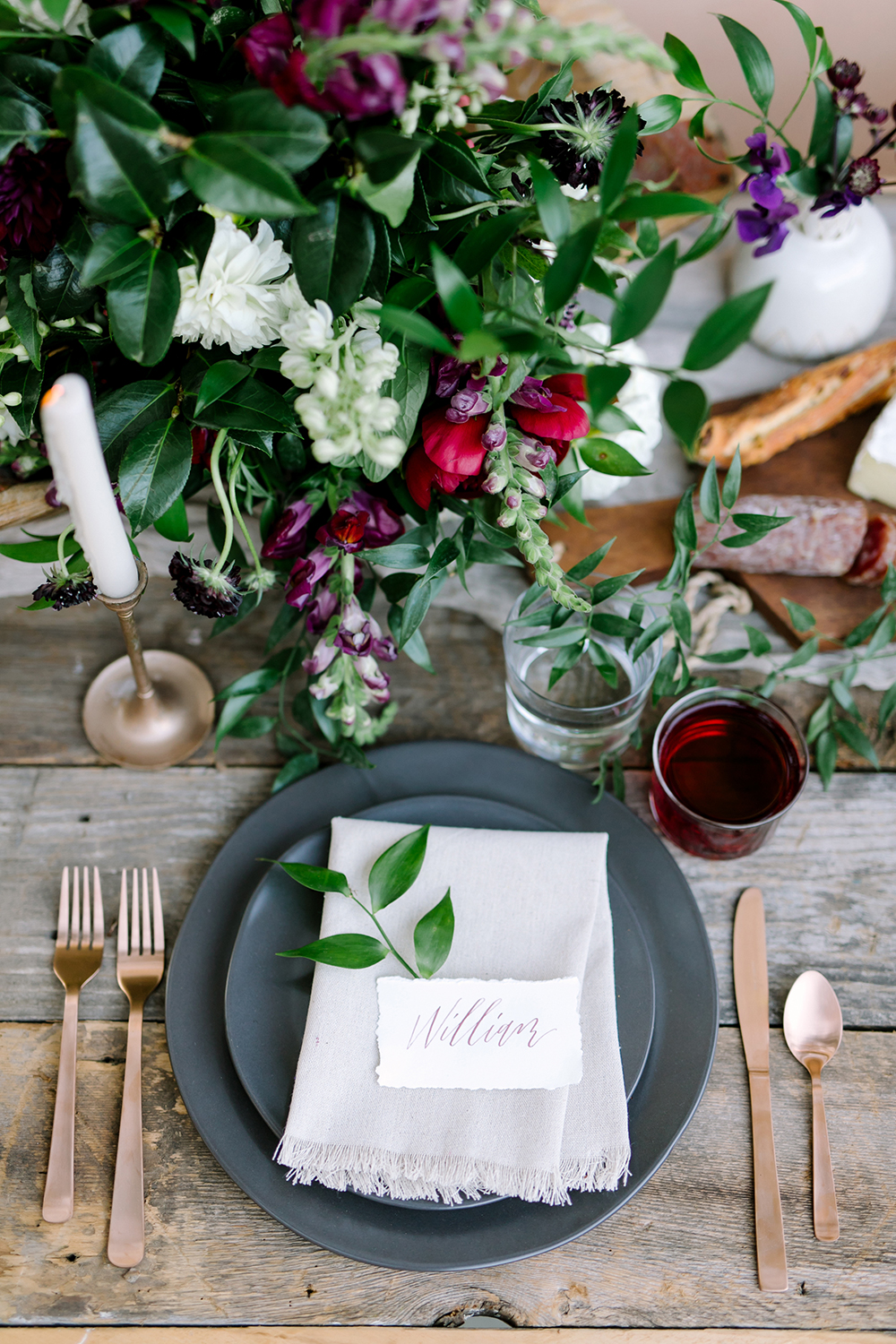dinner place setting - photo by Julie Wilhite https://ruffledblog.com/european-inspired-jewel-toned-wedding-ideas
