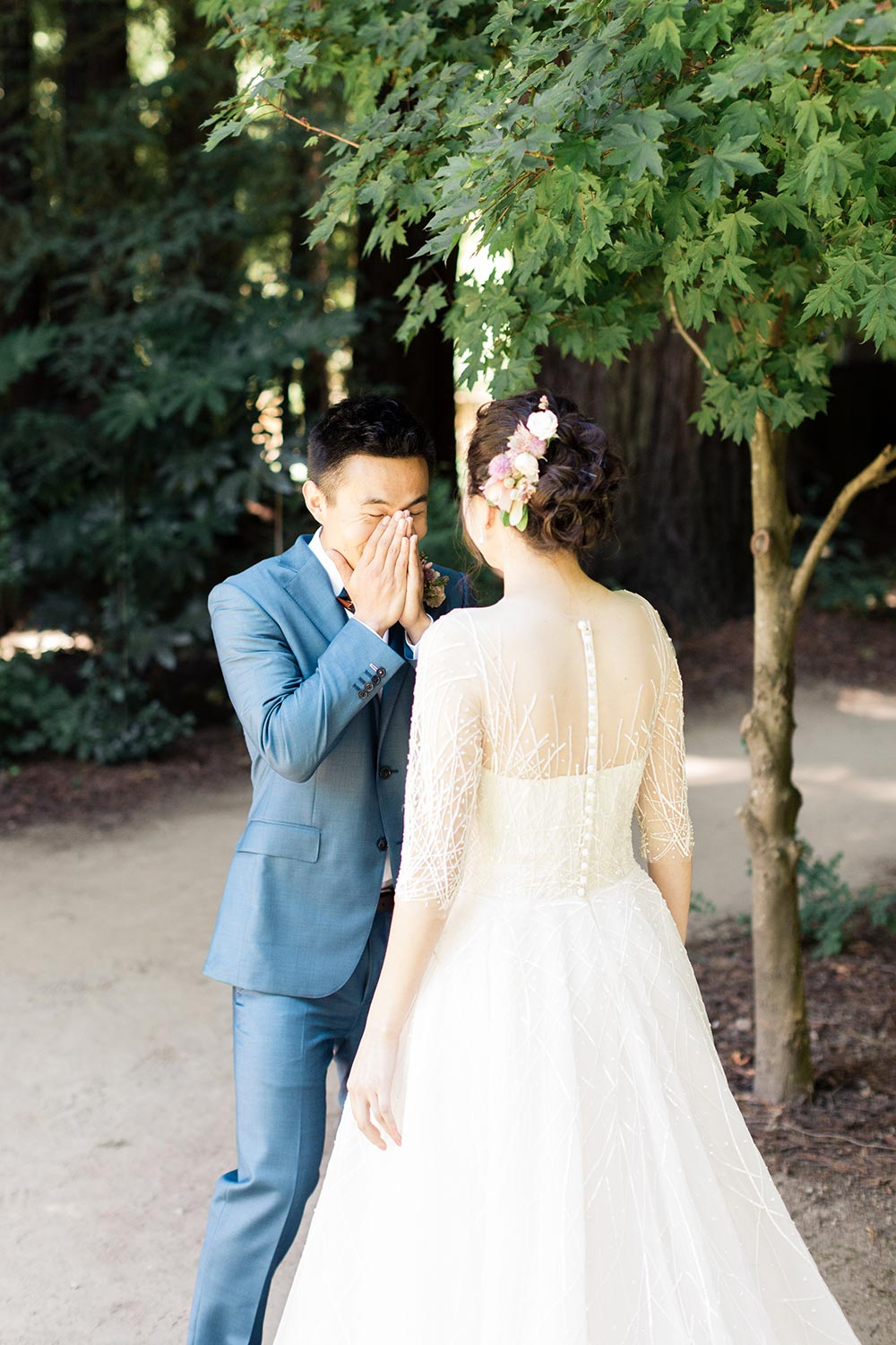 modern and classical longsleeve wedding dress and blue groom suit first look