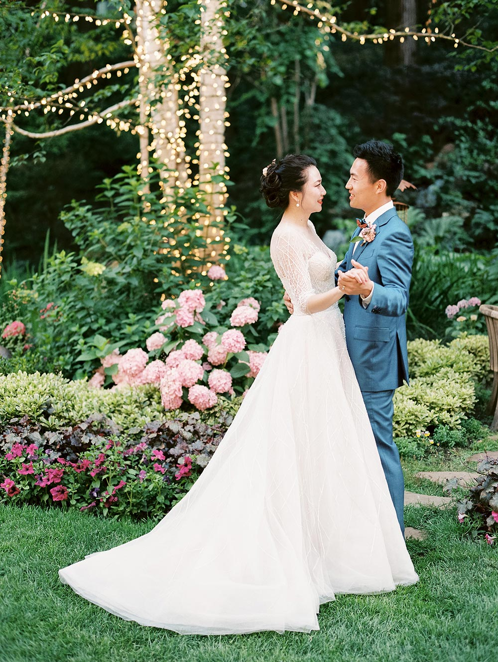 modern and classical longsleeve wedding dress and blue groom suit