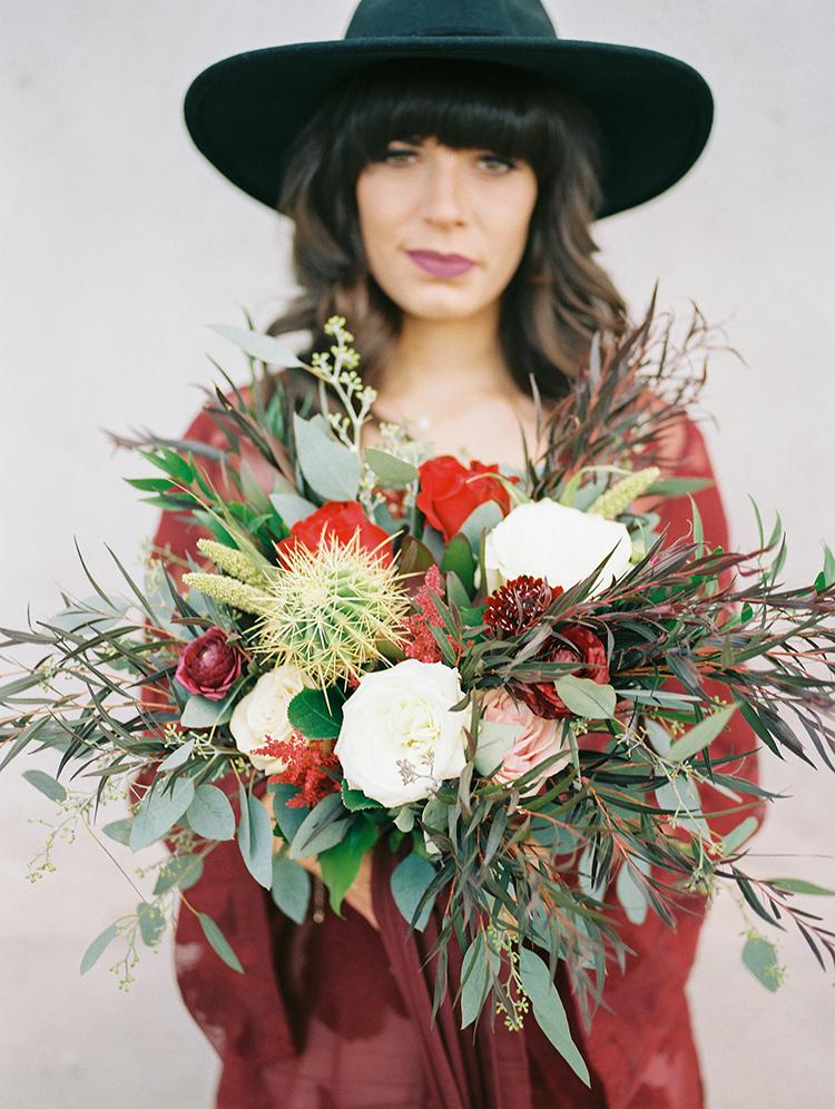 unique desert wedding bouquets - https://ruffledblog.com/fall-desert-elopement-inspiration-with-burgundy-and-lavender