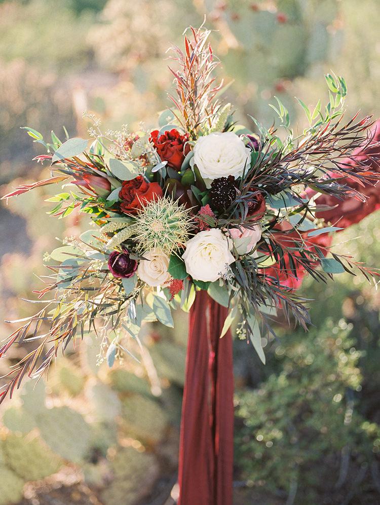 desert wedding bouquets - https://ruffledblog.com/fall-desert-elopement-inspiration-with-burgundy-and-lavender