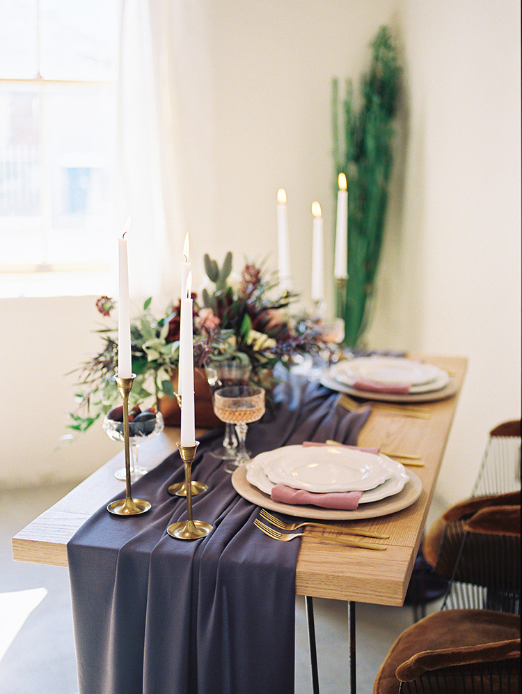 wedding tables with purple details - https://ruffledblog.com/fall-desert-elopement-inspiration-with-burgundy-and-lavender