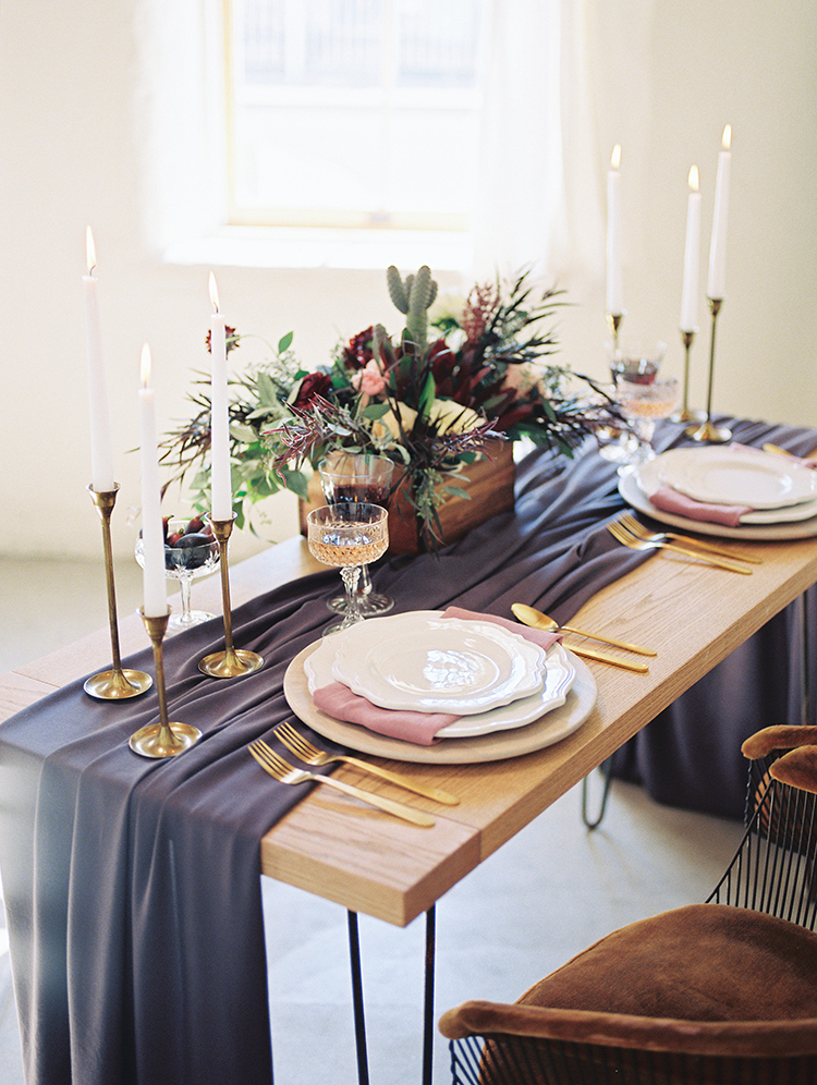 romantic wedding tables with purple runners - https://ruffledblog.com/fall-desert-elopement-inspiration-with-burgundy-and-lavender