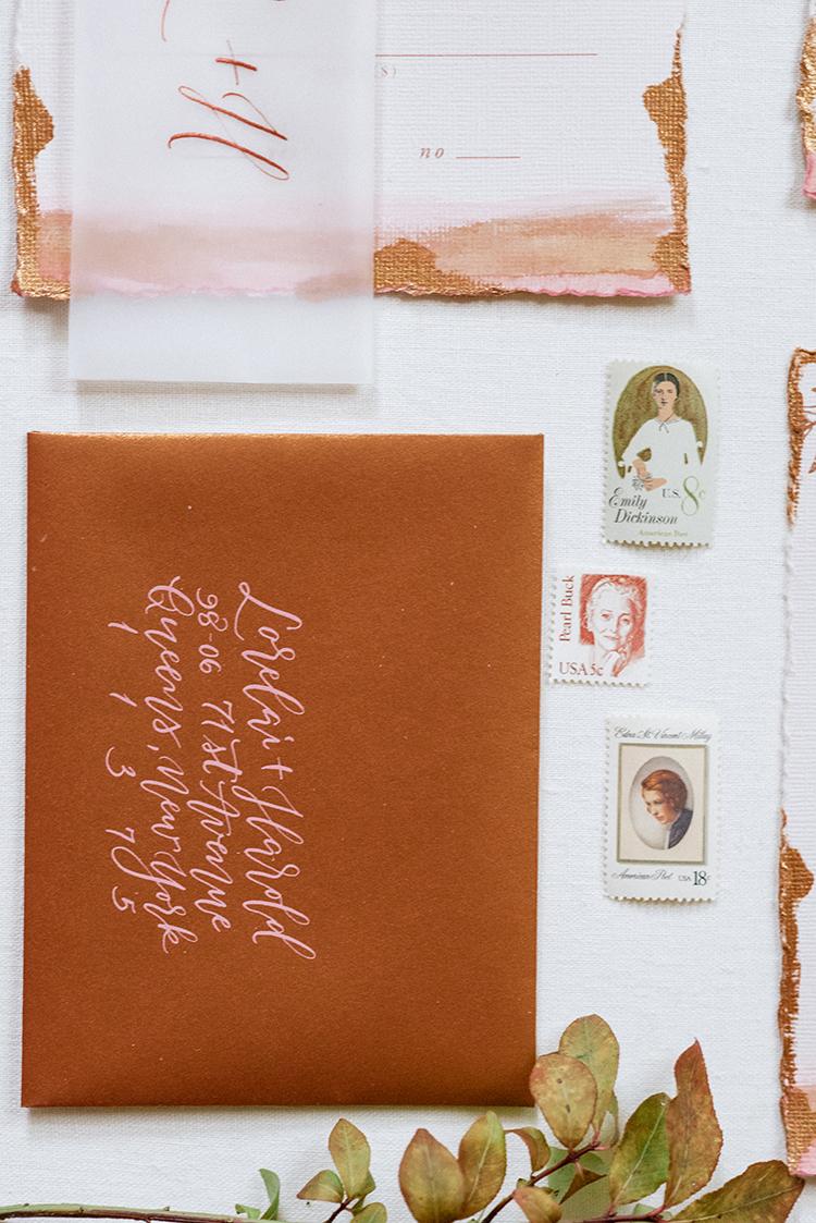 copper wedding invitation envelopes - http://ruffledblog.com/fall-wedding-inspiration-with-mauve-and-apricot-hues
