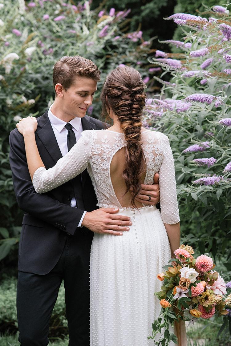 fishtail braid wedding hair - http://ruffledblog.com/fall-wedding-inspiration-with-mauve-and-apricot-hues