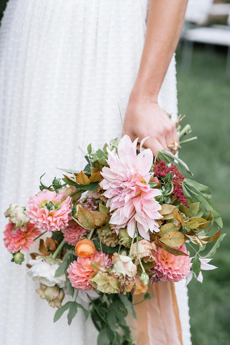peachy pink bouquet with dahlias - http://ruffledblog.com/fall-wedding-inspiration-with-mauve-and-apricot-hues